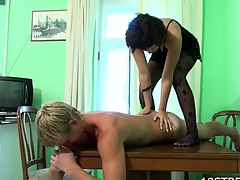 Horny darksome brown strips and bonks with her stud on table